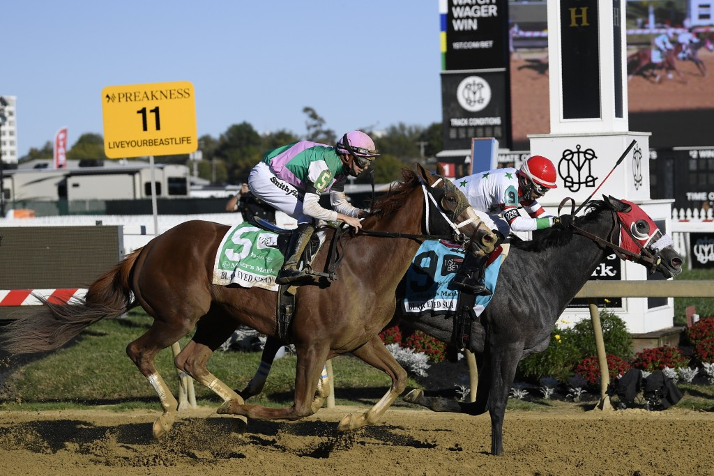 Miss Marissa, right, with Daniel Centeno aboard, wins the Black Eyed Susan horse race at Pimlico Race Course with Bonny South, with Florent Geroux abo...