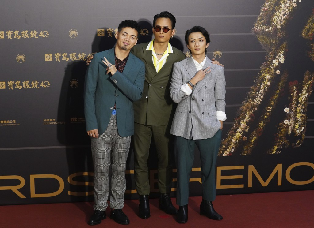 Taiwanese pop group ''EggPlantEgg'' pose as they arrive for the 31th Golden Melody Awards in Taipei, Taiwan, Saturday, Oct. 3, 2020. The awards show, ...