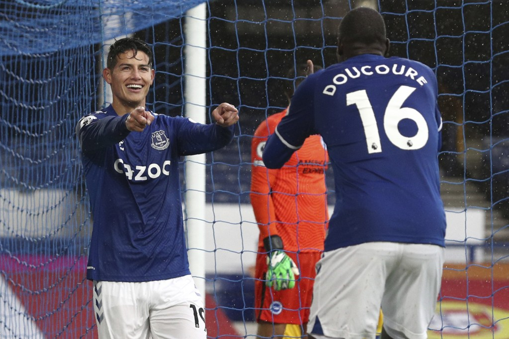 Everton's James Rodriguez, left, celebrates after scoring his side's fourth goal during the English Premier League soccer match between Everton and Br...