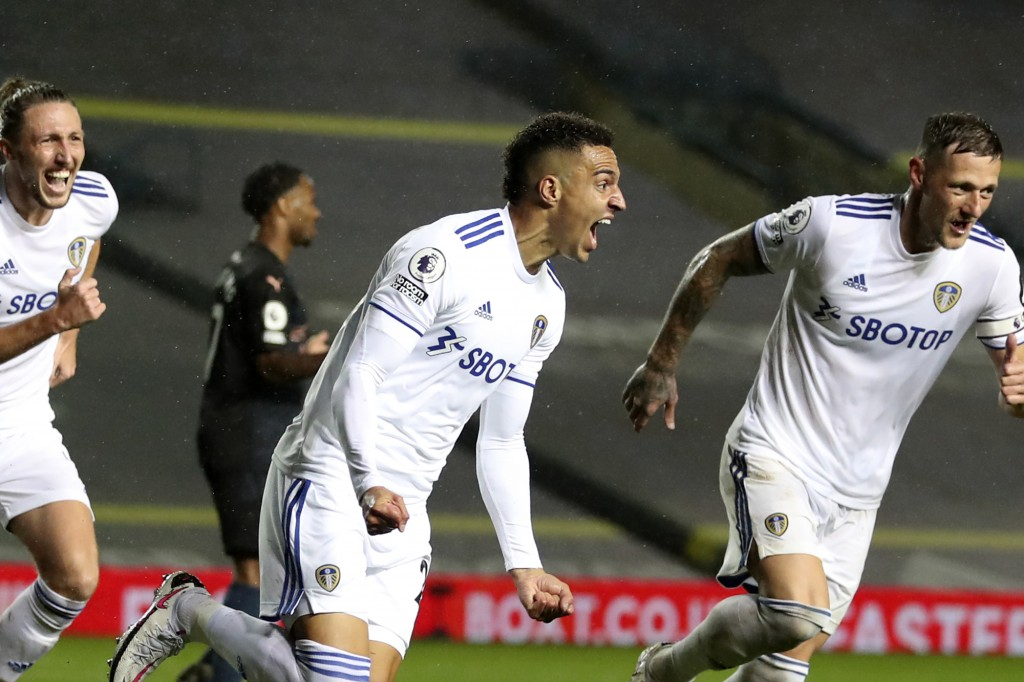Leeds United's Rodrigo, center, celebrates after scoring his side's first goal during the English Premier League soccer match between Leeds United and...