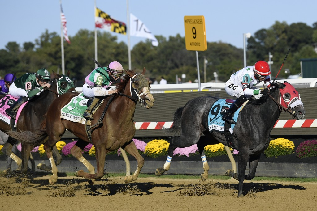 Miss Marissa (9), with Daniel Centeno aboard, runs down the track to win the Black Eyed Susan horse race at Pimlico Race Course, Saturday, Oct. 3, 202...