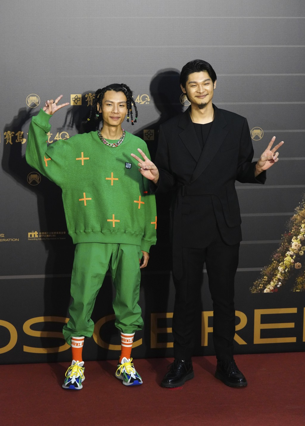 "Taiwanese singer Leo Wang, right, of pop musical group ""Yeemao"" poses on arrival at the 31th Golden Melody Awards in Taipei, Taiwan, Saturday, Oct. 3,..."