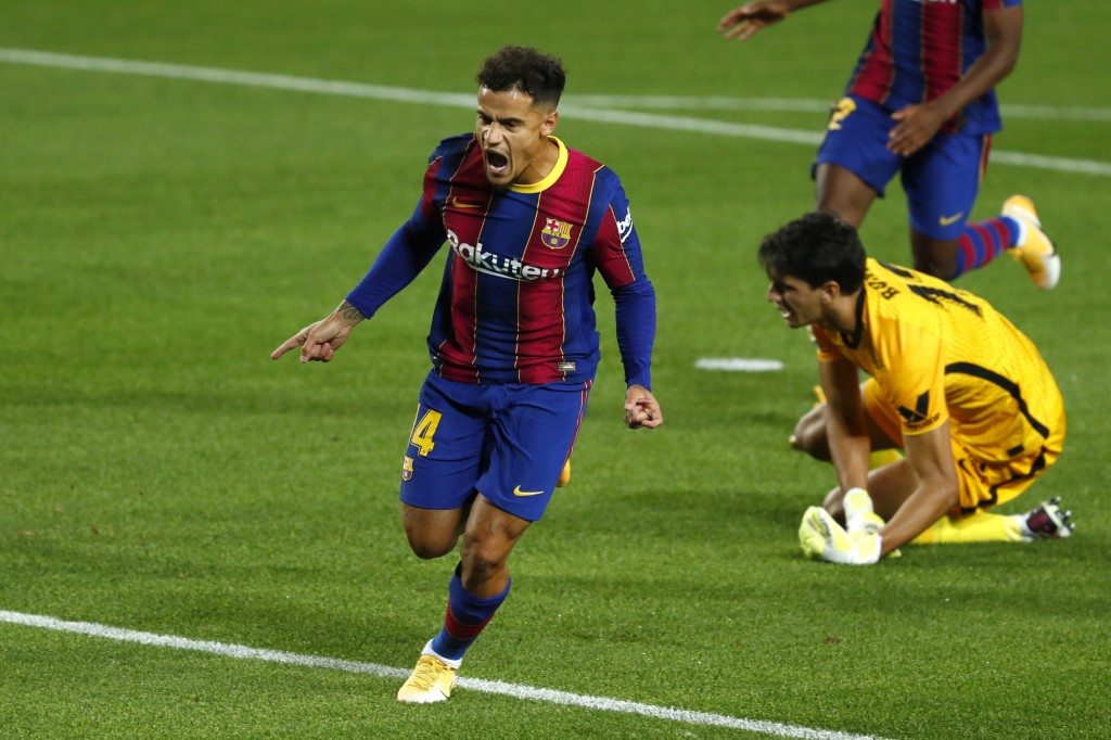 Barcelona's Philippe Coutinho celebrates scoring the opening goal during the Spanish La Liga soccer match between FC Barcelona and Sevilla FC at the C...