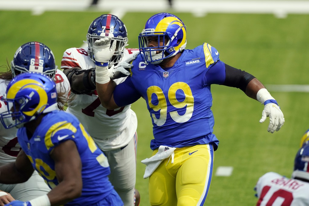 Los Angeles Rams defensive end Aaron Donald, right, works against the New York Giants during the first half of an NFL football game Sunday, Oct. 4, 20...