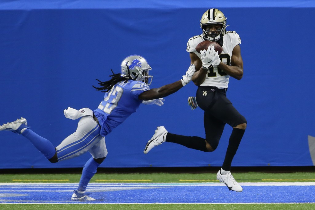 New Orleans Saints wide receiver Tre'Quan Smith, defended by Detroit Lions cornerback Desmond Trufant, catches a 20-yard pass for a touchdown during t...
