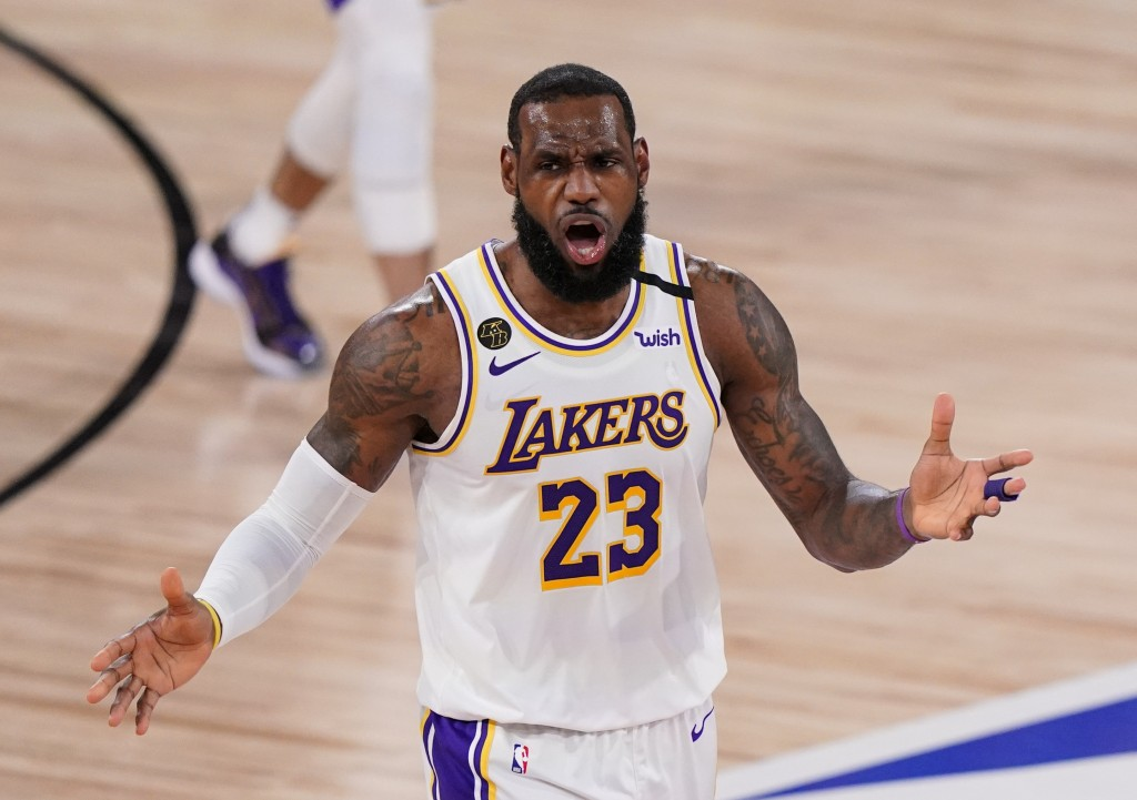 Los Angeles Lakers' LeBron James (23) reacts after no foul was called against the Miami Heat during the second half in Game 3 of basketball's NBA Fina...