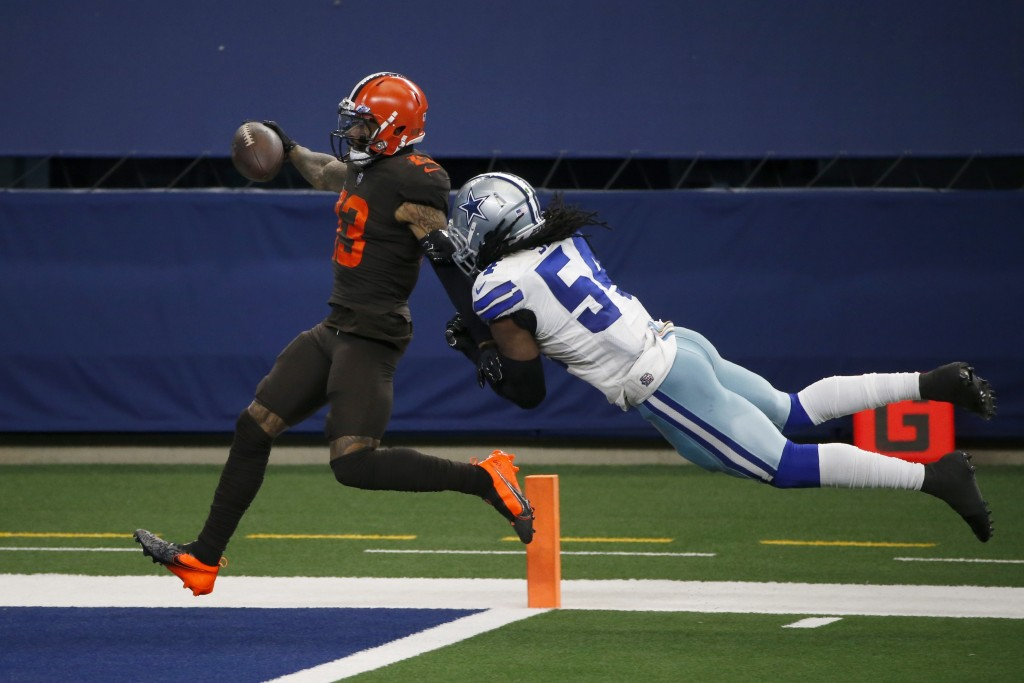 Cleveland Browns wide receiver Odell Beckham Jr. (13) scores a touchdown after a long run as Dallas Cowboys linebacker Jaylon Smith (54) attempts the ...