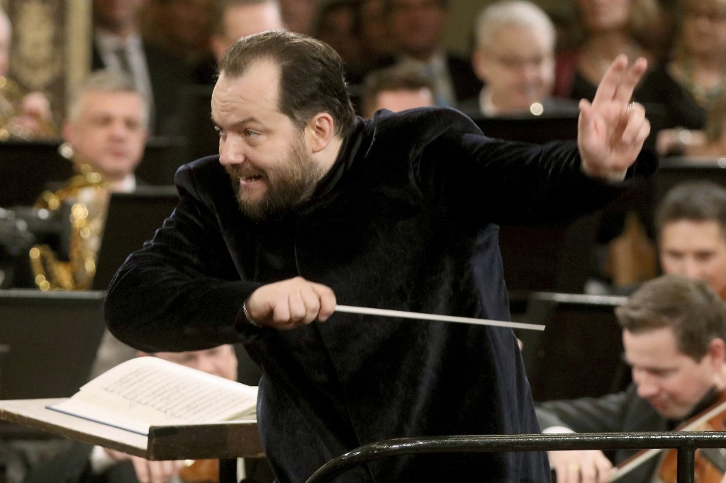 FILE - In this Jan. 1, 2020, file photo, Andris Nelsons conducts the Vienna Philharmonic Orchestra during the traditional New Year's concert at the go...