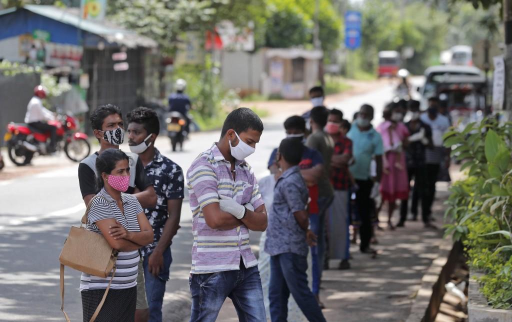 Sri Lankans wait to give swab samples to test for COVID-19 outside a hospital in Minuwangoda, Sri Lanka, Tuesday, Oct. 6, 2020. (AP Photo/Eranga Jayaw...