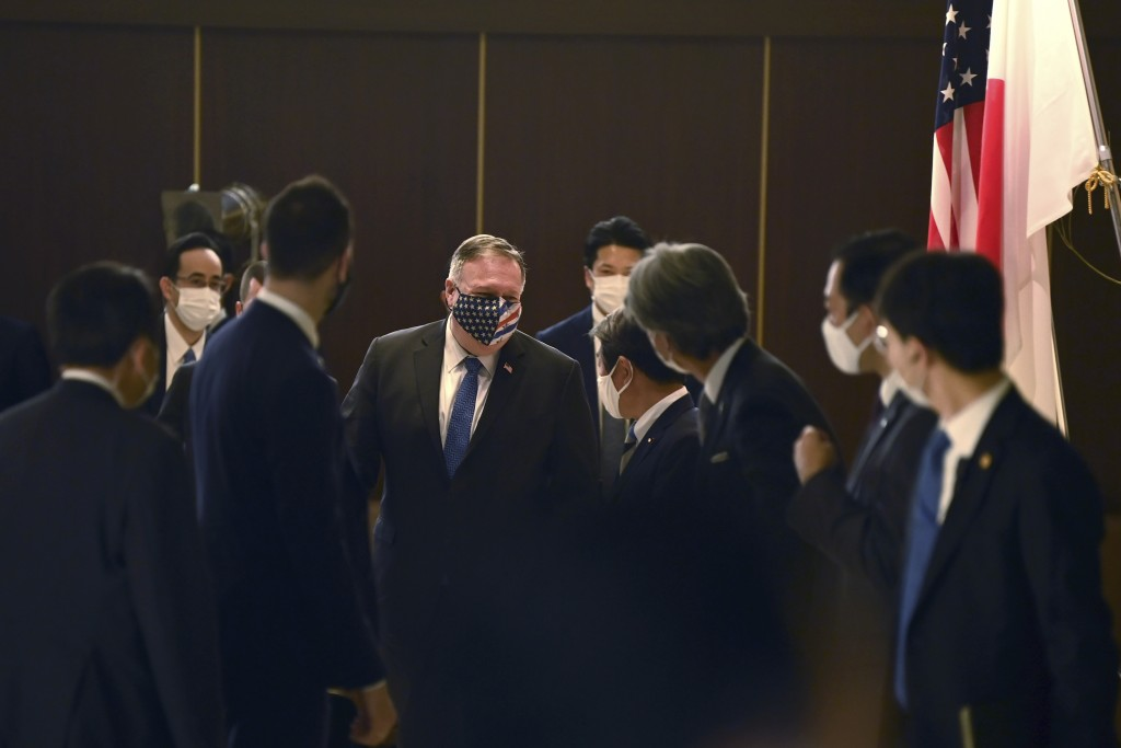 Japan's Foreign Minister Toshimitsu Motegi, center right, greets U.S. Secretary of State Mike Pompeo, center left, prior to their bilateral meeting in...