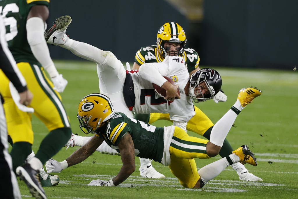 Atlanta Falcons quarterback Matt Ryan (2) is tackled by Green Bay Packers' Jaire Alexander (23) during the second half of an NFL football game, Monday...