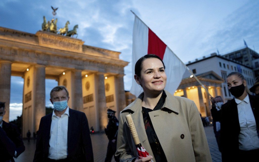 Belarusian opposition leader Svetlana Tikhanovskaya is welcomed by supporters, during a rally, by the Brandenburg Gate in Berlin, Monday, Oct. 5, 2020...