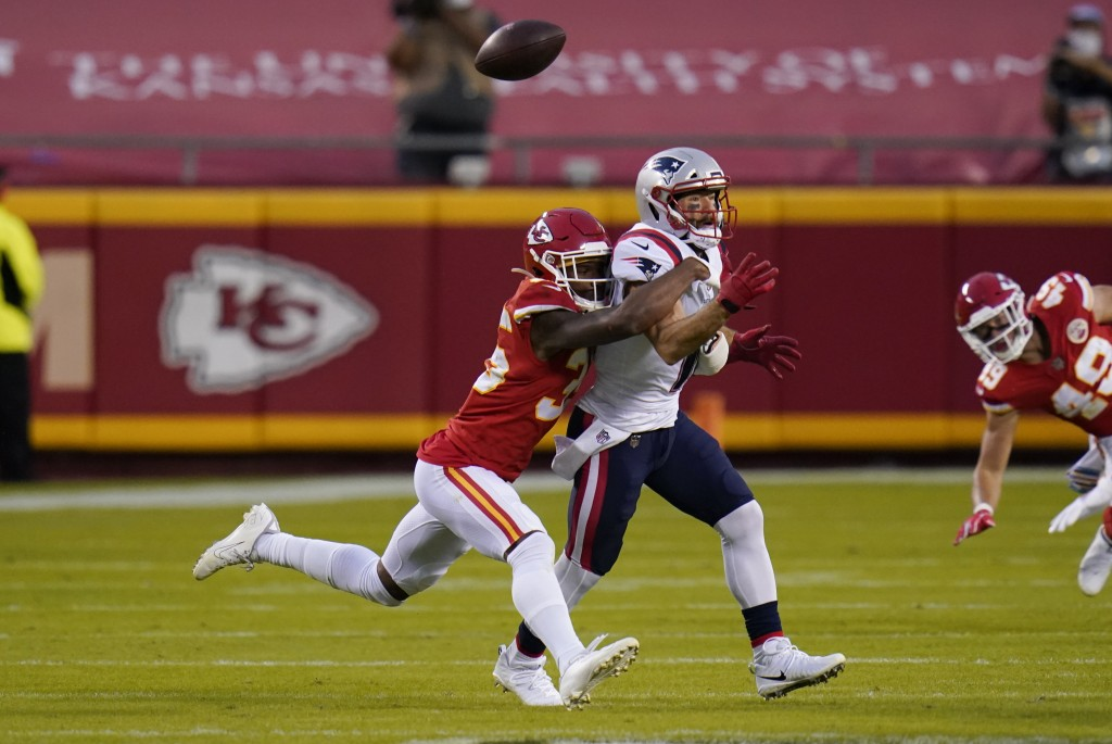 Kansas City Chiefs cornerback Charvarius Ward, left, breaks up a pass intended for New England Patriots wide receiver Julian Edelman during the first ...