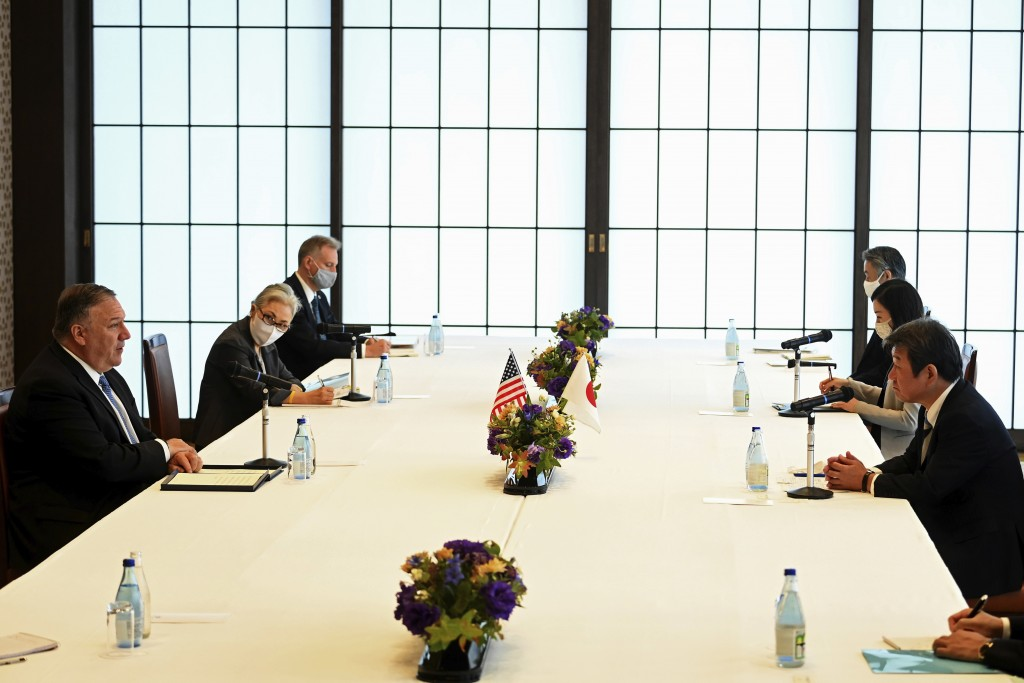 U.S. Secretary of State Mike Pompeo, left, meets with Japan's Foreign Minister Toshimitsu Motegi, right, in Tokyo Tuesday, Oct. 6, 2020 ahead of the f...