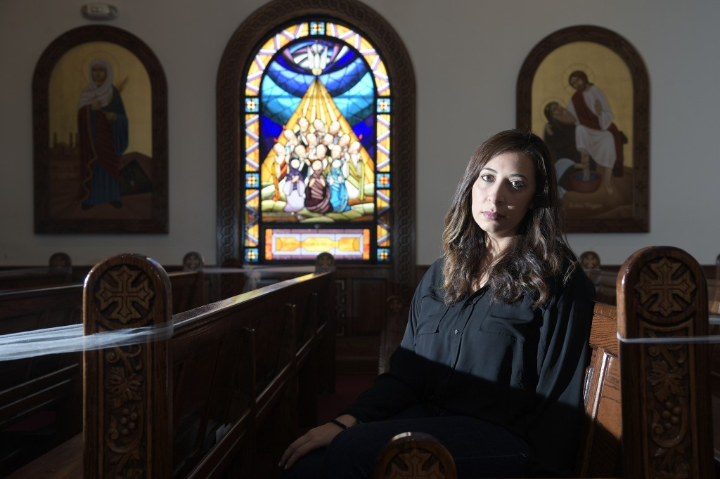 Sally Zakhari sits inside the St. Mary & Archangel Michael Coptic Orthodox Church, Monday, Aug. 24, 2020, in Oviedo, Fla. Zakhari has alleged, includi...