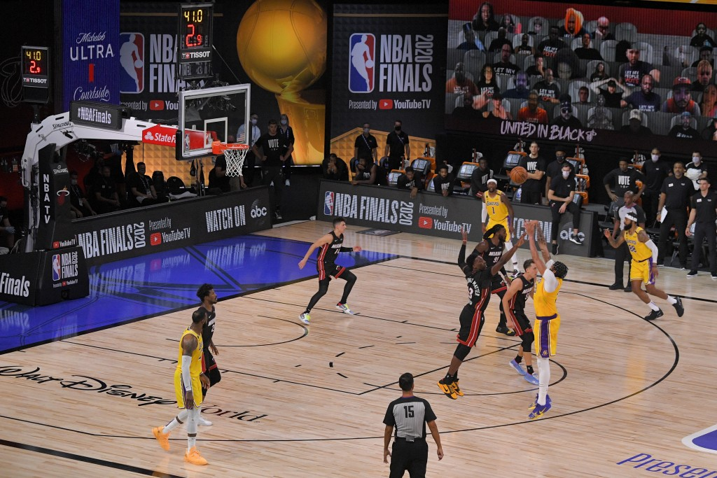 Los Angeles Lakers forward Anthony Davis makes a 3-point basket during the second half in Game 4 of basketball's NBA Finals against the Miami Heat Tue...