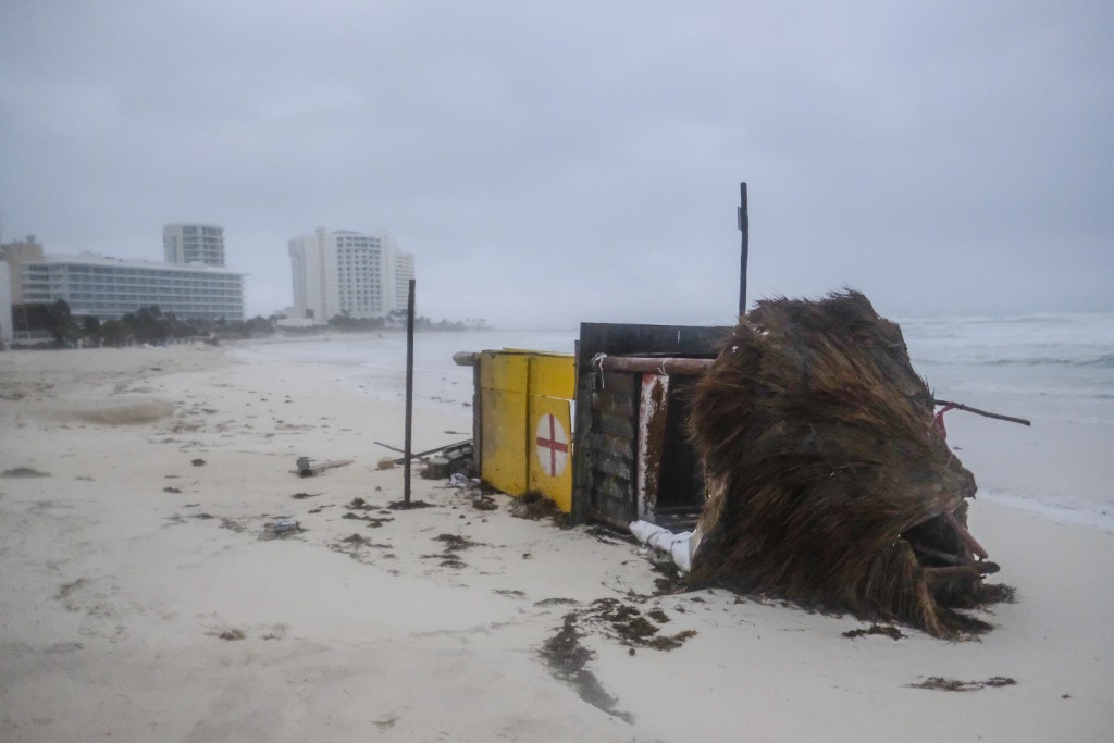 A lifeguard tower lays on its side after it was toppled over by Hurricane Delta in Cancun, Mexico, early Wednesday, Oct. 7, 2020. Hurricane Delta made...