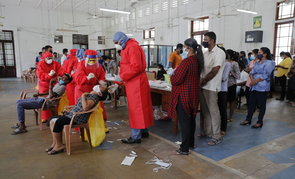 Sri Lankan health officials take swab samples from employees of the Colombo municipal council to test for COVID-19 in Colombo, Sri Lanka, Wednesday, O...