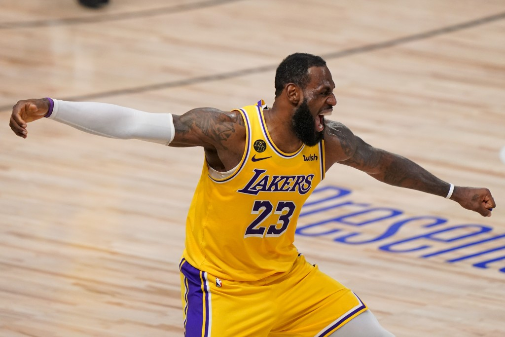 Los Angeles Lakers forward LeBron James celebrates during the second half in Game 4 of basketball's NBA Finals against the Miami Heat Tuesday, Oct. 6,...