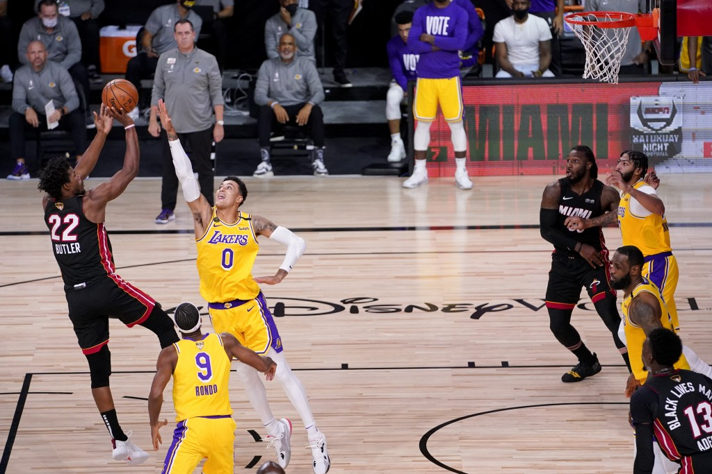 Miami Heat forward Jimmy Butler shoots over Los Angeles Lakers forward Kyle Kuzma during the second half in Game 4 of basketball's NBA Finals Tuesday,...