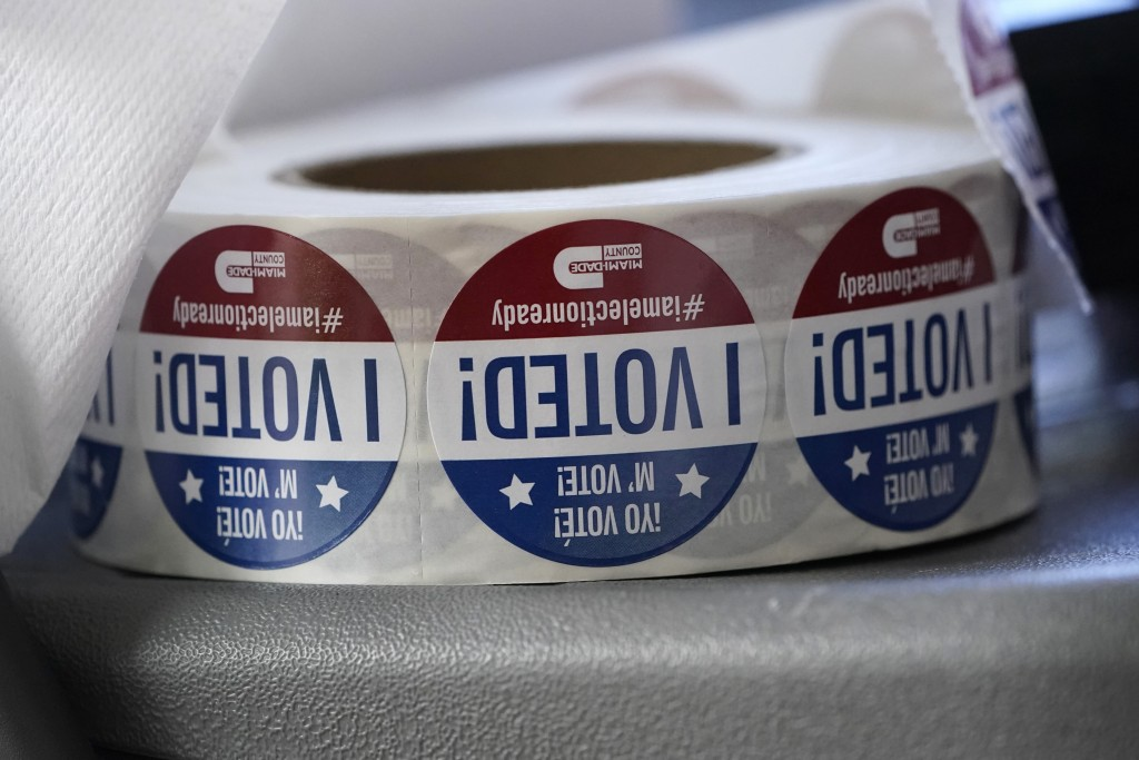 "A roll of ""I Voted!"" stickers are shown, Tuesday, Oct. 6, 2020, at the Miami-Dade County Elections Department in Doral, Fla. Florida Gov. Ron DeSantis..."
