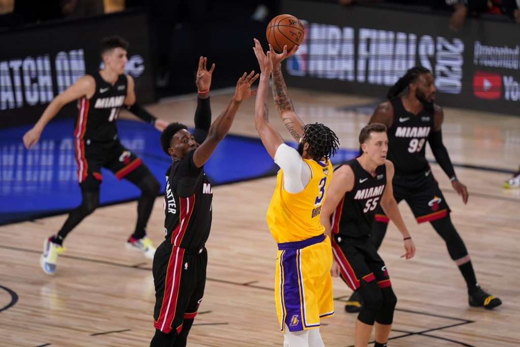 Los Angeles Lakers forward Anthony Davis makes a 3-point basket with 40 seconds left on the clock in Game 4 of basketball's NBA Finals against the Mia...