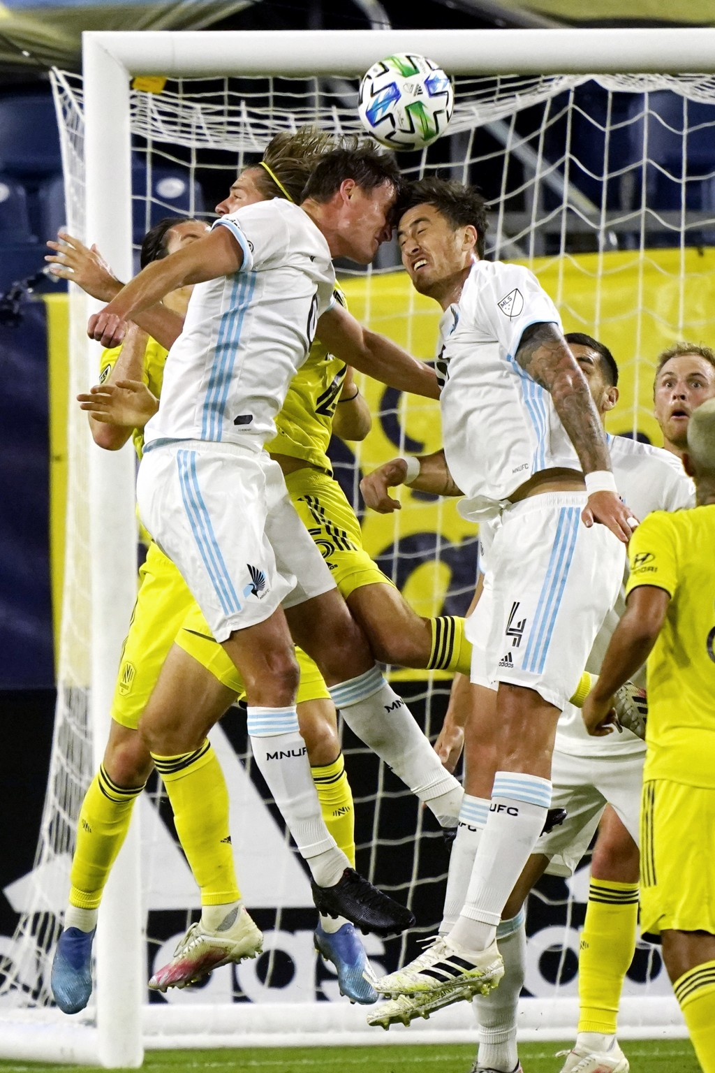 Minnesota United forward Aaron Schoenfeld, left, and defender Jose Aja (4) head the ball in front of the Nashville SC goal during the first half of an...