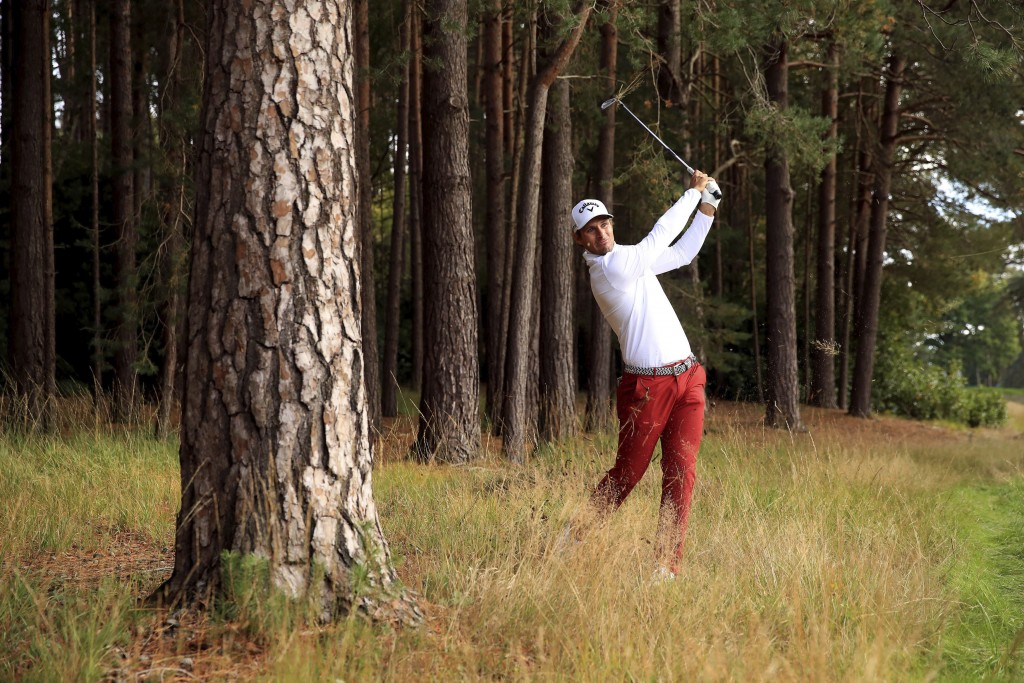 Italy's Andrea Pavan plays out of the rough on the twelfth hole during day one of the PGA Championship at Wentworth Club, Virginia Water, England, Thu...