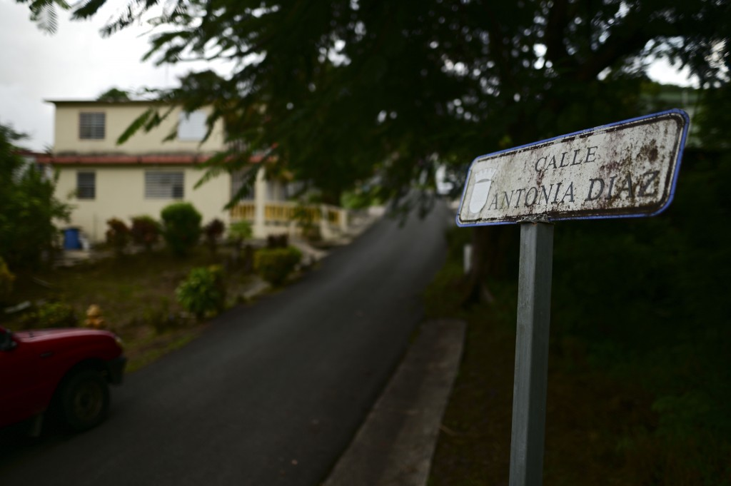 A small, rusty sign identifies Antonia Diaz street in the Cañabón neighborhood of Caguas, Puerto Rico, Wednesday, Sept. 30, 2020. More than half of al...