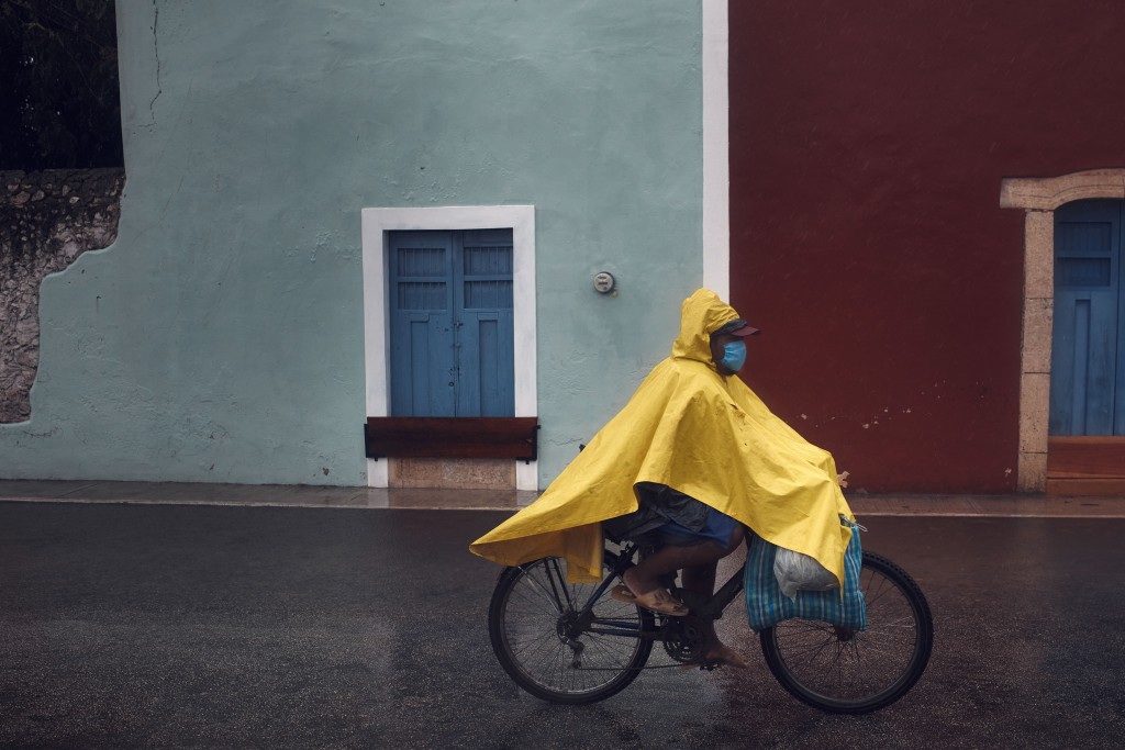 A man cycles along an empty street after the passing of Hurricane Delta in Valladolid, Mexico, Wednesday, Oct. 7, 2020. Hurricane Delta made landfall ...