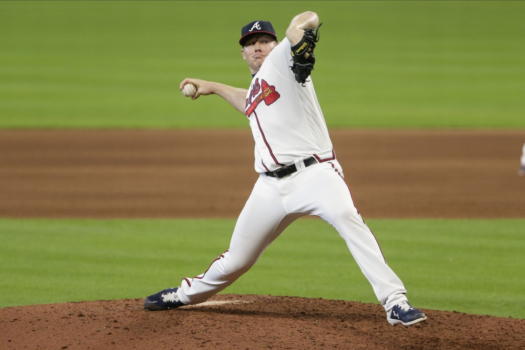 Atlanta Braves' Mark Melancon delivers a pitch during the ninth inning in Game 2 of a baseball National League Division Series against the Miami Marli...