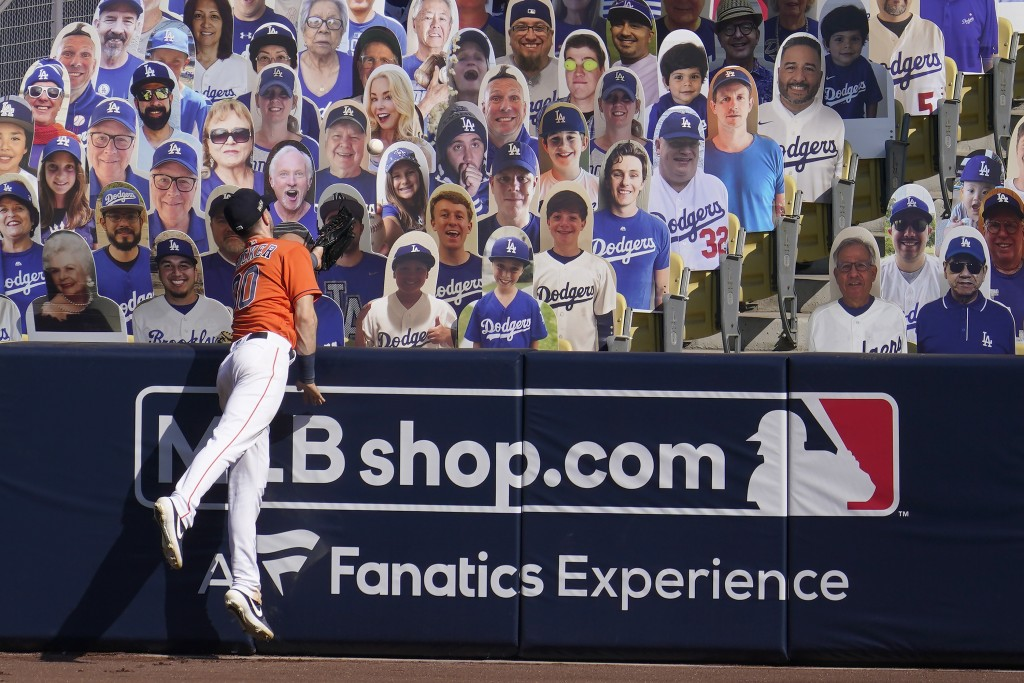 Houston Astros right fielder Kyle Tucker cannot catch a three-run home run hit by Oakland Athletics' Chad Pinder that lands in front of cutouts seated...
