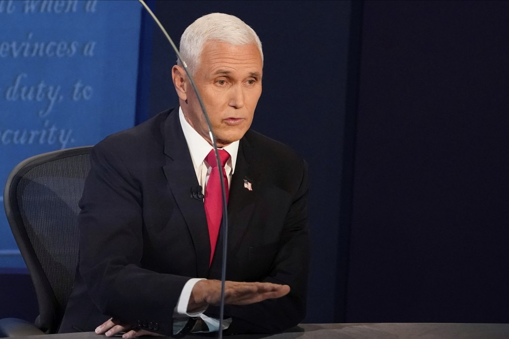 Vice President Mike Pence answers a question during the vice presidential debate Wednesday, Oct. 7, 2020, at Kingsbury Hall on the campus of the Unive...