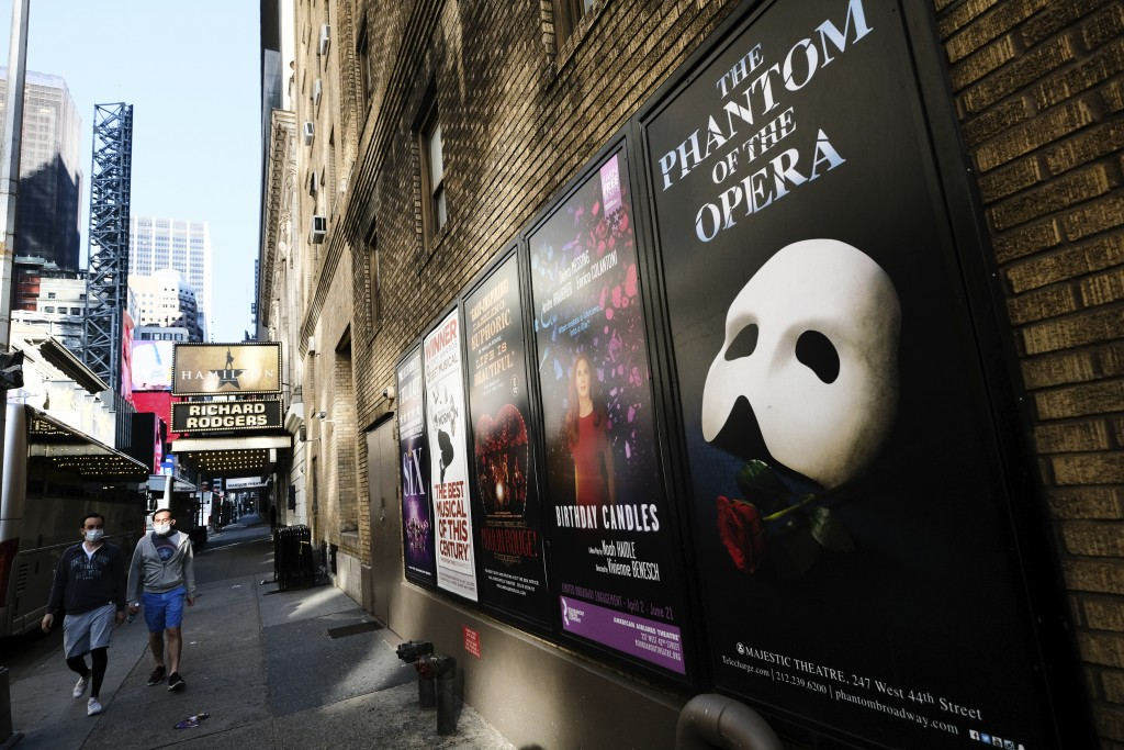 FILE - Broadway posters outside the Richard Rodgers Theatre in New York on May 13, 2020.  Broadway theaters may be dark but there will be plenty of ne...