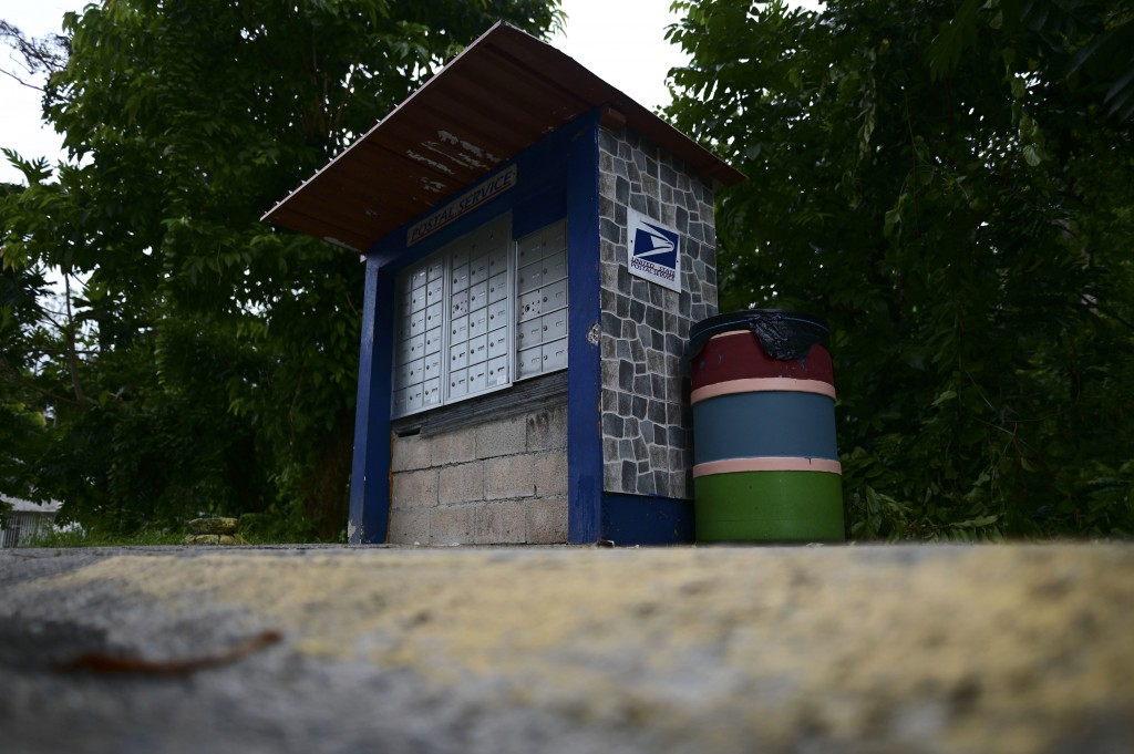 A U.S. Postal Service mailbox stands in a rural area of Caguas, Puerto Rico, Wednesday, Sept. 30, 2020. Many people have their official addresses list...
