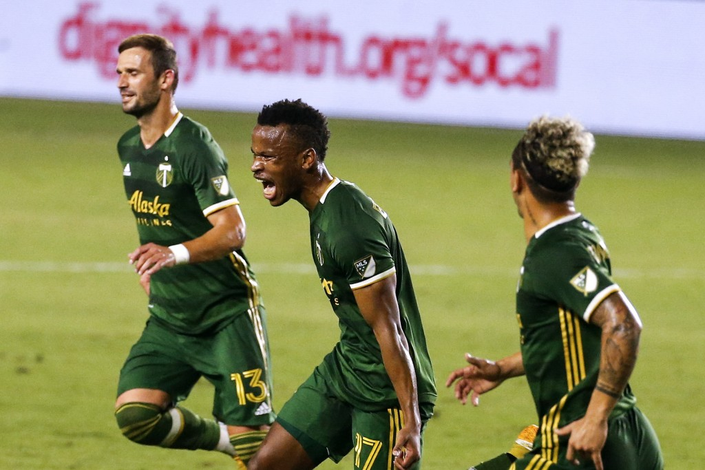 Portland Timbers forward Jeremy Ebobisse, center, celebrates after scoring a goal against the LA Galaxy during the first half of an MLS soccer match i...