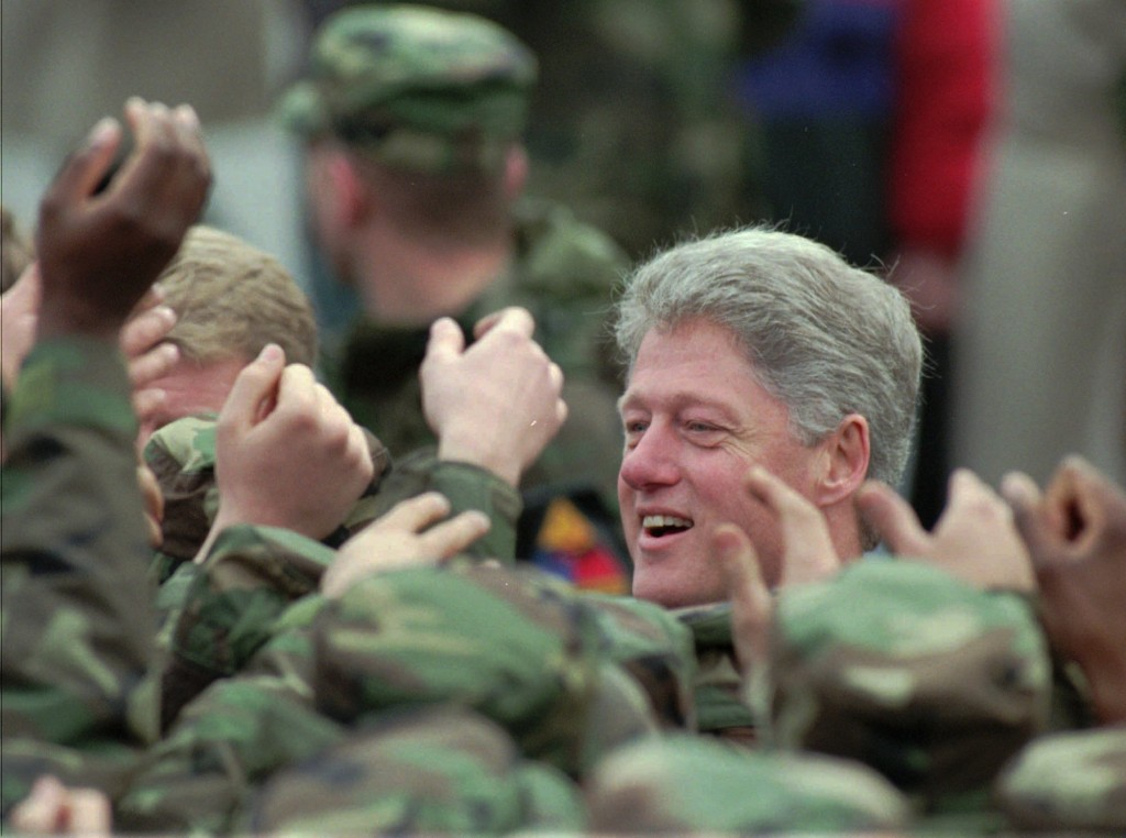FILE - In this Saturday, Dec. 2, 1995 file photo, U.S.President Bill Clinton reaches out to shake hands with soldiers of the Task Force Eagle, the Bos...