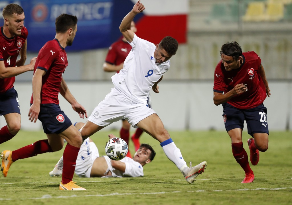Cyprus' Dimitris Christofi, centre, controls the ball during an international friendly soccer match between Cyprus and Czech Republic at AEK arena in ...