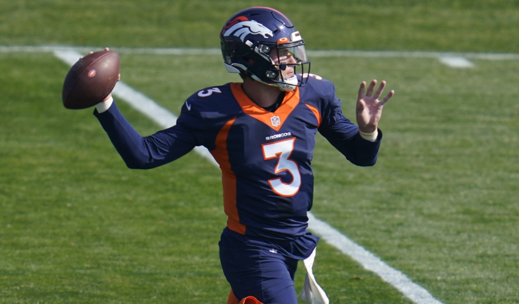 Injured Denver Broncos quarterback Drew Lock takes part in drills during an NFL football practice at the team's training headquarters Wednesday, Oct. ...
