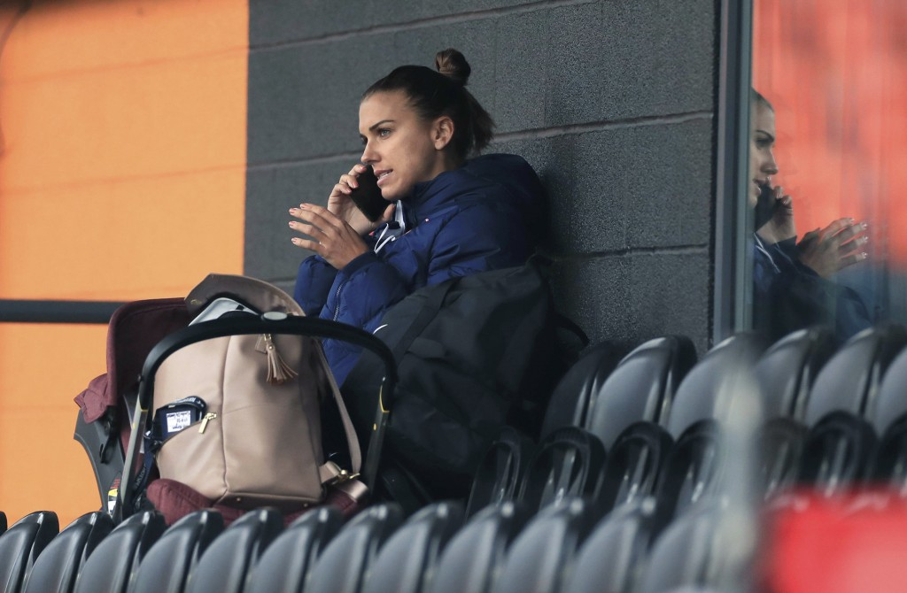 Tottenham Hotspur women's Alex Morgan speaks on her phone in the stands, during the women's Continental League Cup match between Tottenham Hotspur and...