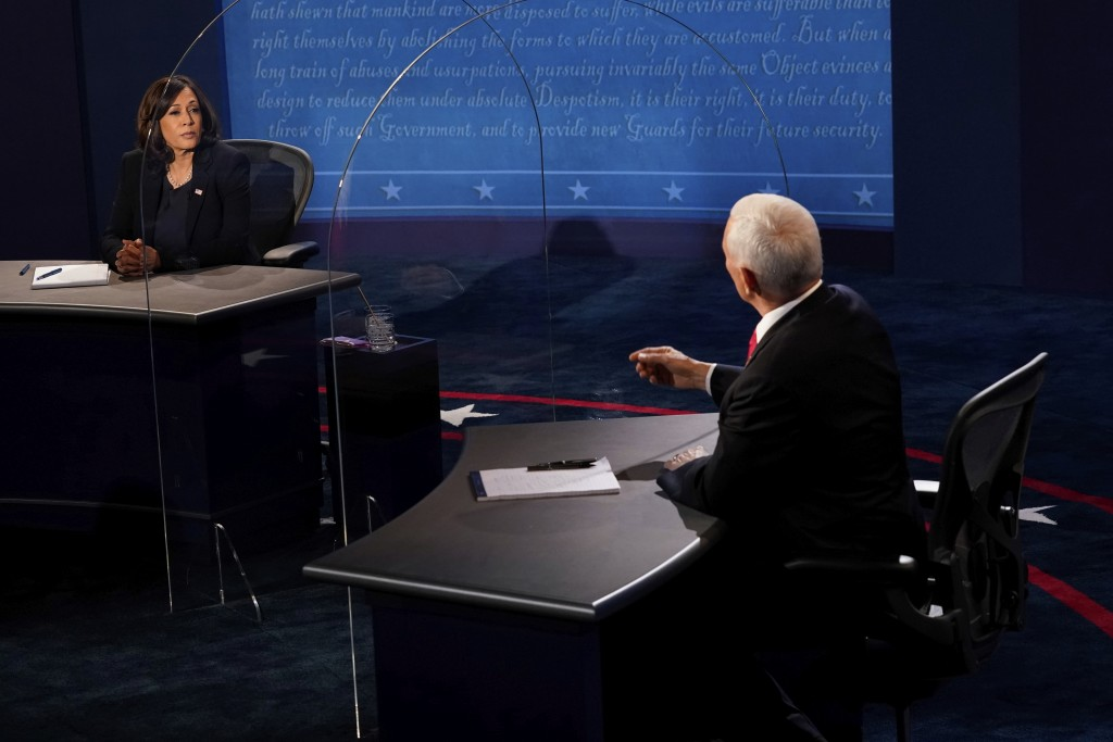 Democratic vice presidential candidate Sen. Kamala Harris, D-Calif., listens as Vice President Mike Pence answers a question during the vice president...