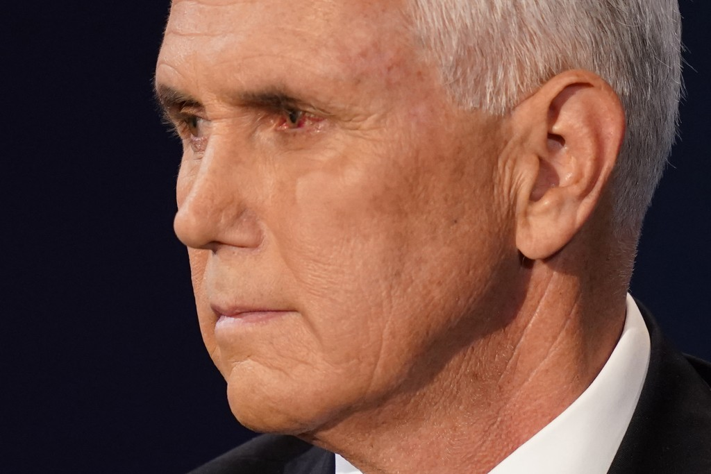 Vice President Mike Pence looks at Democratic vice presidential candidate Sen. Kamala Harris, D-Calif., during the vice presidential debate Wednesday,...