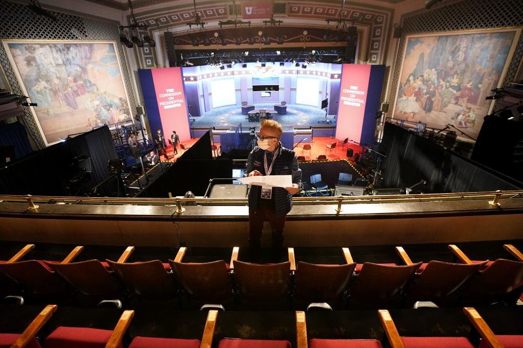 A member of the production staff holds a seating chart while putting labels on chairs socially distanced from each other ahead of the vice presidentia...
