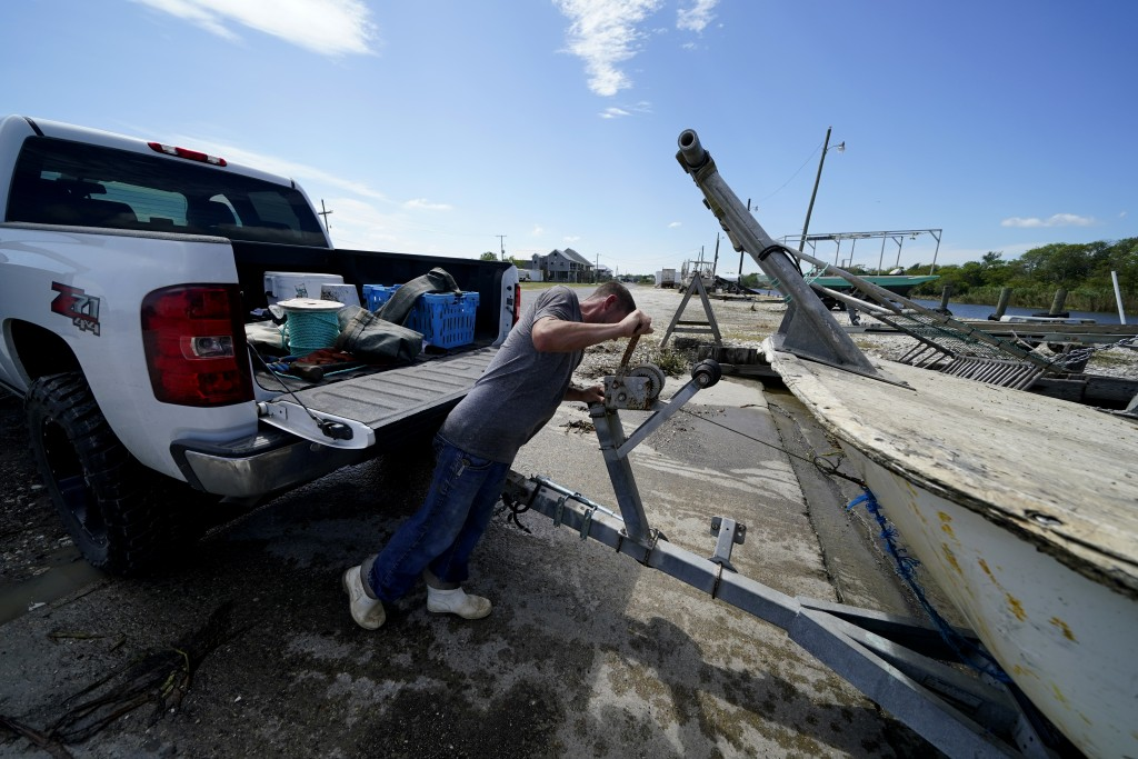 Charles Russ pulls their boat from the water after pulling his crab traps from Bayou Dularge in anticipation of Hurricane Delta, expected to arrive al...