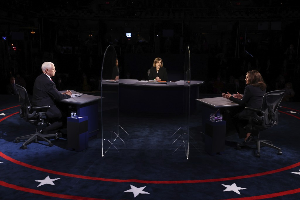 Vice President Mike Pence listens as Democratic vice presidential candidate Sen. Kamala Harris, D-Calif., speaks during the vice presidential debate W...