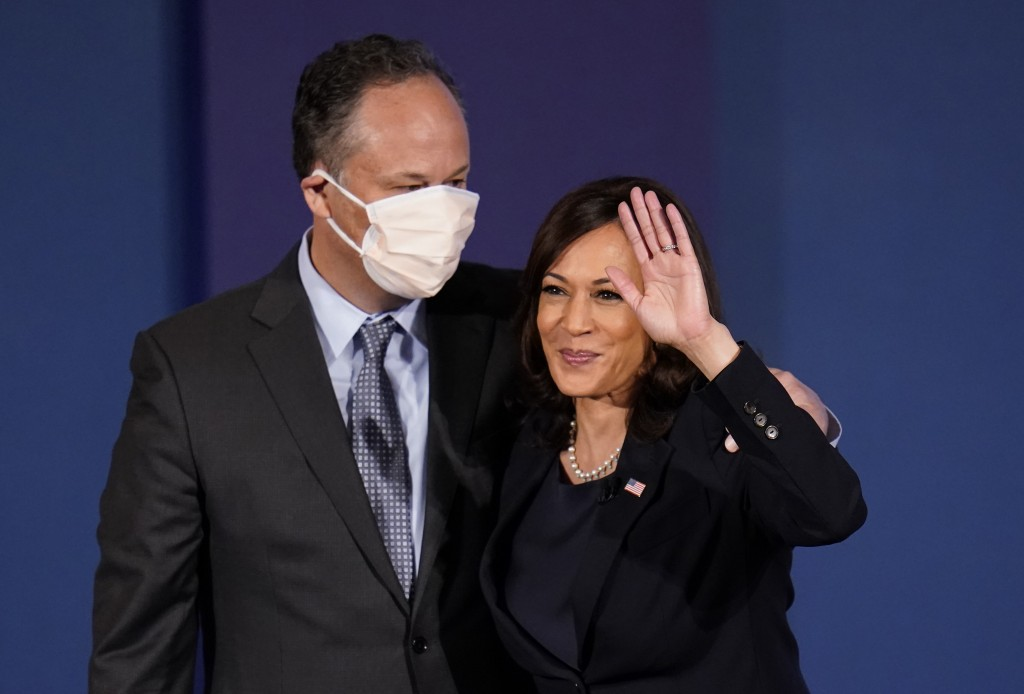 Democratic vice presidential candidate Sen. Kamala Harris, D-Calif., waves with her husband Douglas Emhoff following the vice presidential debate with...