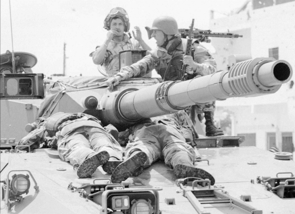 FILE - In this Friday, July 2 1993 file photo, Italian U.N. soldiers transport their wounded comrades on top of a warrior tank to a military hospital ...