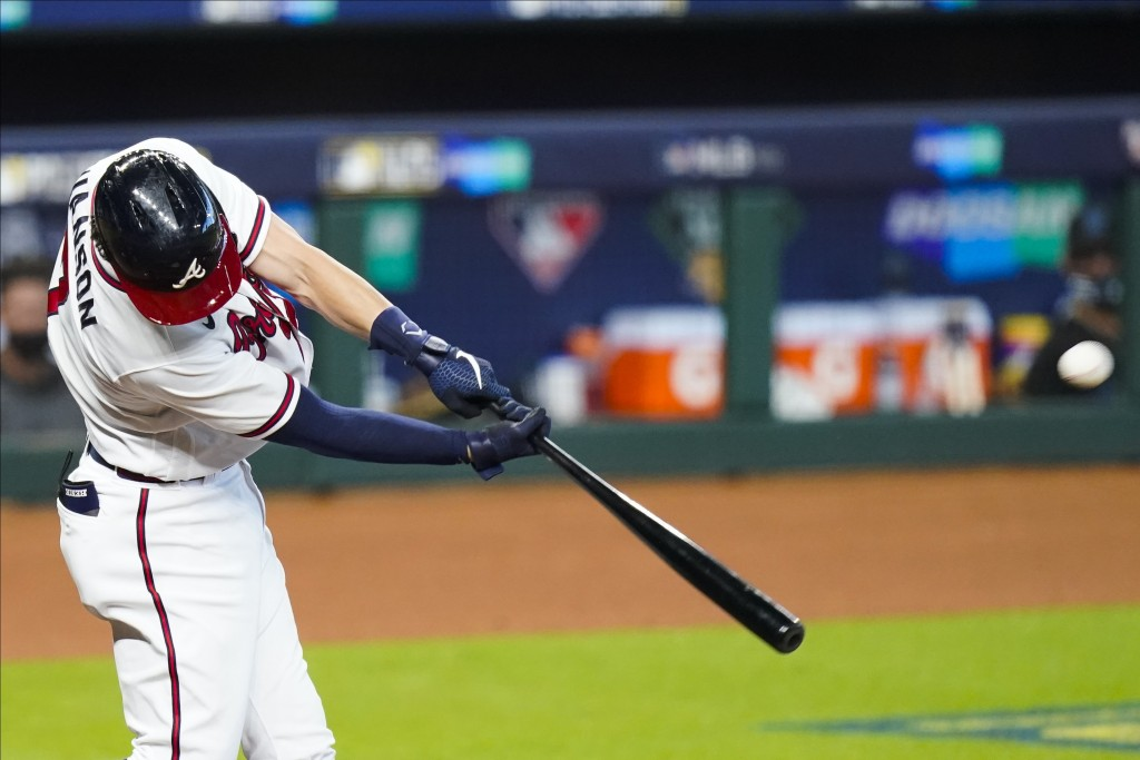 Atlanta Braves' Dansby Swanson hits a home run during the second inning in Game 2 of a baseball National League Division Series against the Miami Marl...