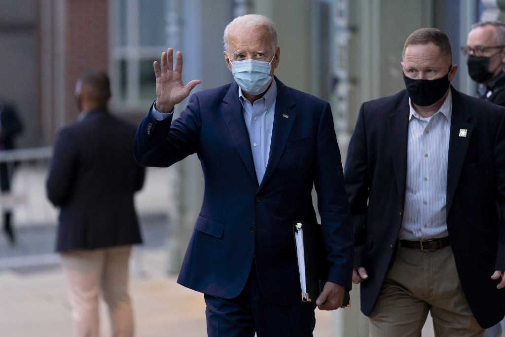Democratic presidential candidate former Vice President Joe Biden leaves the Queen Theater in Wilmington, Del., Wednesday, Oct. 7, 2020. (AP Photo/And...