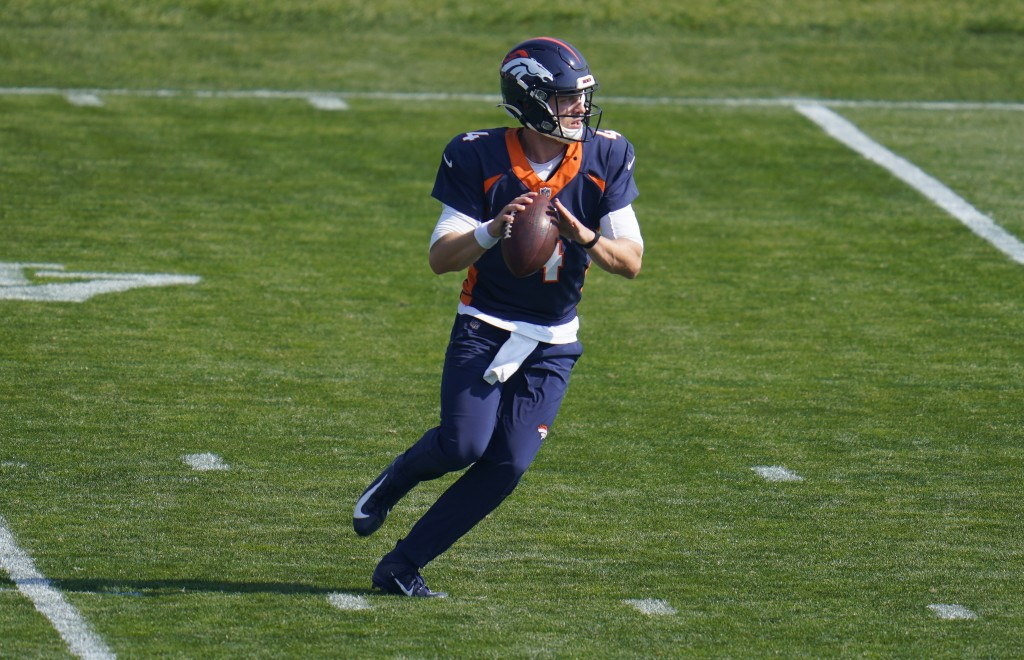 Denver Broncos quarterback Brett Rypien takes part in drills during NFL football practice at the team's training headquarters Wednesday, Oct. 7, 2020,...